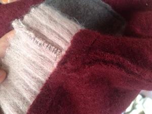 Cuff sewn with zig-zag stitch.
