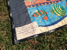 Label reads: May this quilt be a window to your dreams!