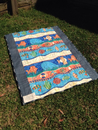 Quilt back: rather awesome curtain panel!
