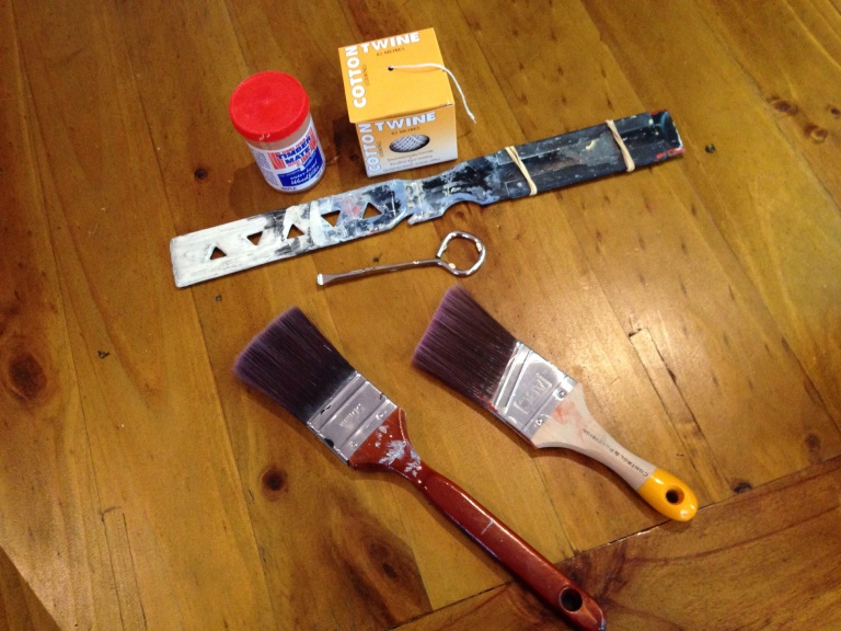Wood filler, string, paint stirrer, paint can opener, brushes.