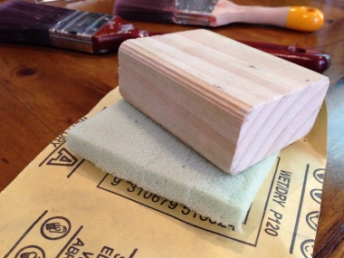 Sanding block with foam and paper.