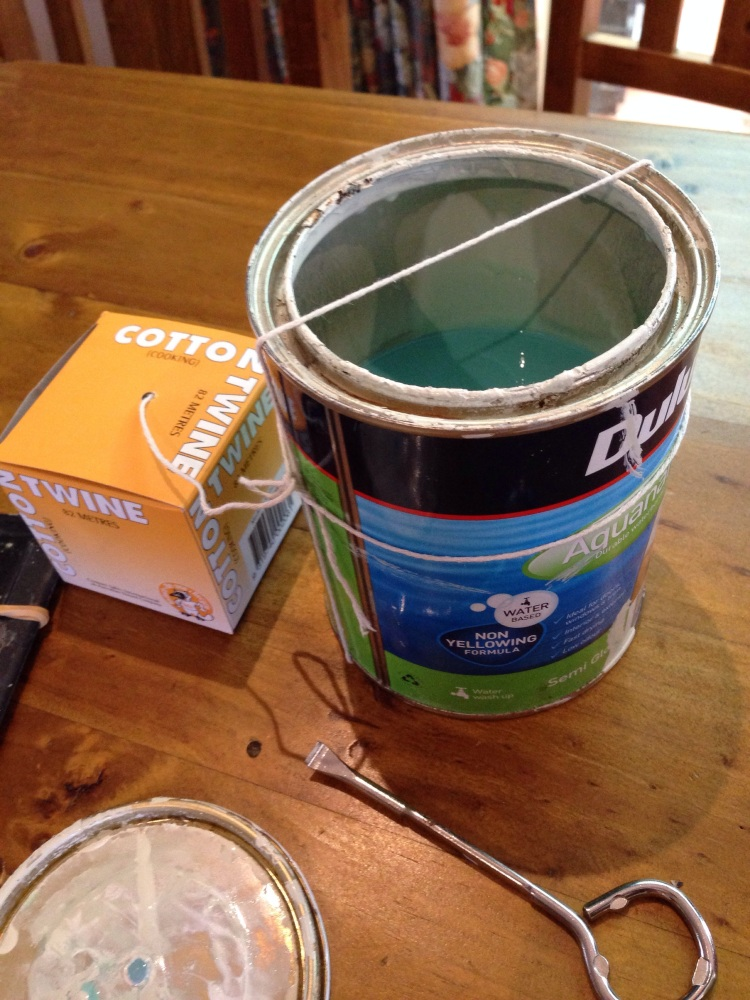 String tied onto paint can.