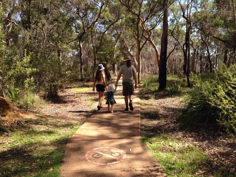 Stephen and the Kids walking along a bush path