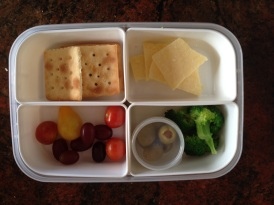 Salada biscuits, cheese, tomatoes, grapes, olives, cooked broccoli