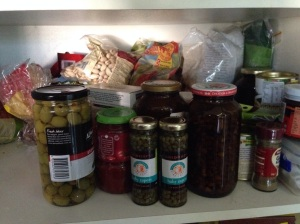 Cluttered pantry shelf