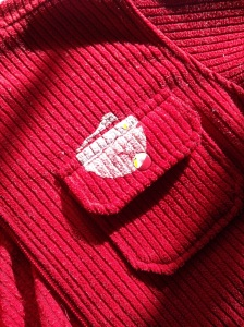 Sticker stain on red jacket