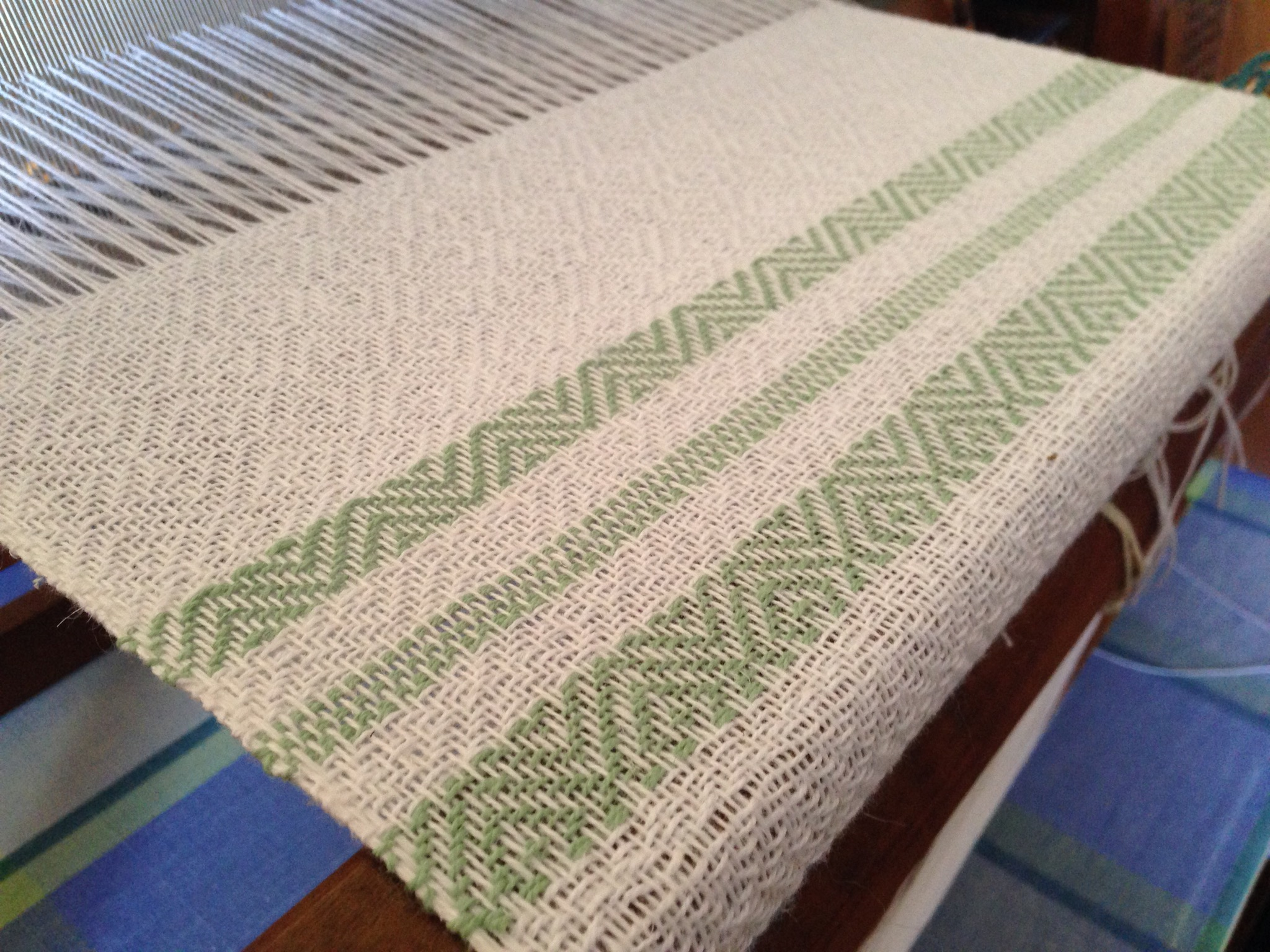 Green sample on the loom