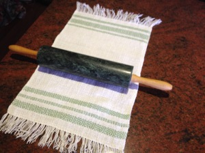 Mangling the towel with a rolling pin.