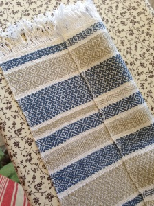 Striped coloured towel with twill patterns