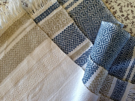 Three handwoven tea towels